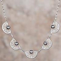 Sterling silver filigree pendant necklace, 'Sparkling Half-Moons' - Sterling Silver Filigree Semicircle Pendant Necklace