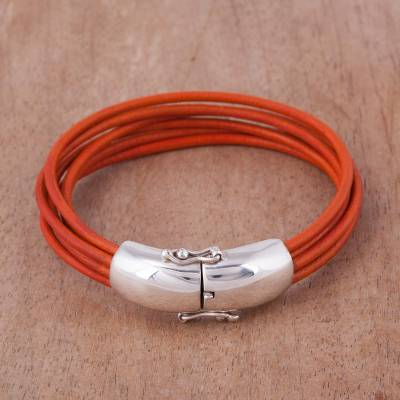 Leather wristband bracelet, 'Orange Passion' - Handcrafted Orange Leather Wristband Bracelet from Peru