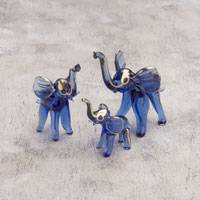 Blown glass gold leaf figurines, 'Cheerful Elephant Trio' (set of 3) - Three Gold Leaf Blown Glass Elephant Figurines from Peru
