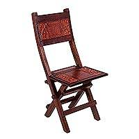 Wood and leather folding chair, 'Hacienda Ferns' - Tooled Leather and Wood Folding Chair with Andean Style