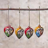 Ceramic ornaments, 'Nativity Hearts' (set of 4) - Four Heart-Shaped Ceramic Nativity Ornaments from Peru
