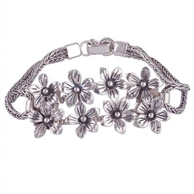 Sterling silver pendant bracelet, 'Peruvian Lilies' - Fair Trade Sterling Silver Floral Bracelet from Peru