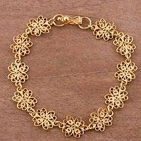 Gold plated sterling silver filigree link bracelet, 'Glistening Flowers'