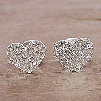 Sterling silver stud earrings, 'Enamored Hearts' - Heart-Shaped Sterling Silver Stud Earrings from Peru