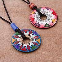 Ceramic pendant necklaces, 'You and I' (pair) - Hand Painted Pink and Blue Ceramic Pendant Necklaces (pair)