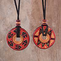 Ceramic pendant necklaces, 'Enchanted Land' (pair) - Pair of Red and Black Ceramic Pendant Necklaces from Peru