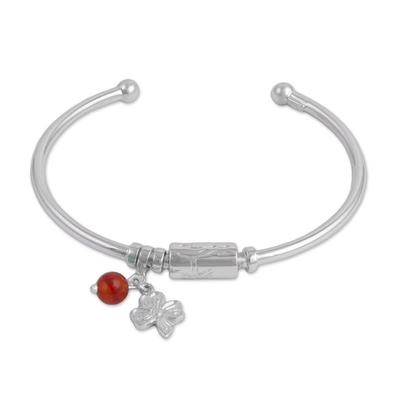 Carnelian charm cuff bracelet, 'Fortune Smiles' - Sterling Silver Clover Charm Carnelian Bead Cuff Bracelet