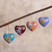 Ceramic ornaments, 'Love Quartet' (set of 4) - Hand Painted Ceramic Heart-Shaped Ornaments (Set of 4)