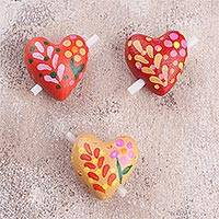 Ceramic figurines, 'Love Flowers' (set of 3) - Three Floral Ceramic Heart Figurines from Peru