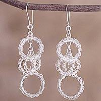 Sterling silver dangle earrings, 'Circular Glory' - Peruvian Long Sterling Silver Dangle Earrings with Rings