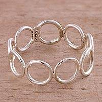 Sterling silver band ring, 'Circle Simplicity' - Sterling Silver Connected Circles Band Ring