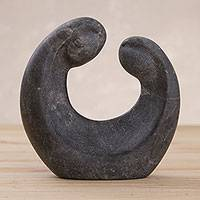 Huamanga stone sculpture, 'Romance Unfurls in Black' - Handcrafted Black Alabaster Sculpture of a Couple in Love