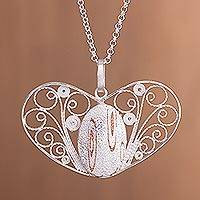 Sterling silver filigree pendant necklace, 'Heartstrings' - Handcrafted Sterling Silver Filigree Heart Pendant Necklace
