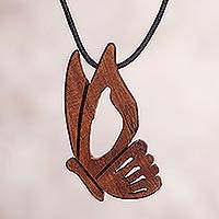 Wood pendant necklace, 'Beautiful Explorer' - Peruvian Reclaimed Wood Butterfly Pendant Necklace