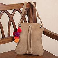 Suede sling, 'Urban Traveler in Beige' - Tan Suede Shoulder Bag Sling with Colorful Pompoms from Peru