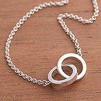 Silver pendant necklace, 'Eternal Union' - Ringed Silver Pendant Necklace Crafted in Peru