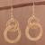 Gold plated filigree dangle earrings, 'Looped in Gold' - Gold-Plated Sterling Silver Filigree Circles Dangle Earrings (image 2) thumbail