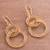 Gold plated filigree dangle earrings, 'Looped in Gold' - Gold-Plated Sterling Silver Filigree Circles Dangle Earrings (image 2b) thumbail