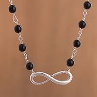 Onyx pendant necklace, 'Mysterious Infinity' - Infinity Motif Onyx Beaded Pendant Necklace from Peru