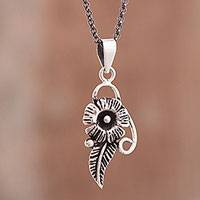 Sterling silver pendant necklace, 'Legendary Flower' - Floral Sterling Silver Pendant Necklace from Peru