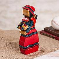 Wood sculpture, 'Selling Flowers' - Handcrafted Wood Sculpture of a Flower Seller from Peru