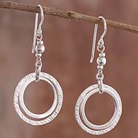Sterling silver dangle earrings, 'Outer Rings' - Ring-Shaped Sterling Silver Dangle Earrings from Peru
