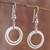 Sterling silver dangle earrings, 'Outer Rings' - Ring-Shaped Sterling Silver Dangle Earrings from Peru (image 2) thumbail