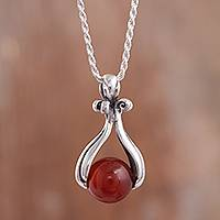Carnelian pendant necklace, 'Majestic Cradle' - Round Carnelian Pendant Necklace from Peru