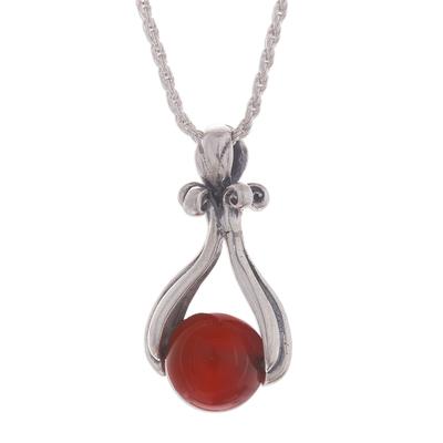 Carnelian pendant necklace, 'Majestic Cradle' - Round Carnelian Pendant Necklace from Peru