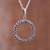 Sterling silver pendant necklace, 'Cosmic Circle' - Circular Sterling Silver Pendant Necklace Crafted in Peru thumbail
