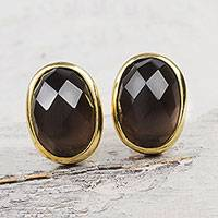 Gold accented obsidian button earrings,