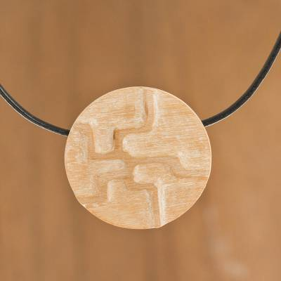 Reclaimed wood pendant necklace, 'Circle of Energy' - Hand-Carved Reclaimed Wood Pendant Necklace from Peru