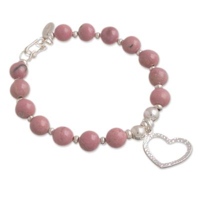 Rhodonite beaded bracelet, 'Love Fascination' - Rhodonite Beaded Bracelet with Heart Charm from Peru
