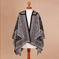 Reversible hooded alpaca blend ruana, 'Game of Aces in Black' - Knit Alpaca Blend Ruana in Black and White from Peru