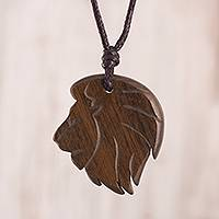Wood pendant necklace, 'King of the Lions' - Hand-Carved Lion Wood Pendant Necklace from Peru