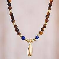 Gold accented tiger's eye and lapis lazuli beaded pendant necklace, 'Stellar Gleam' - Gold Accented Tiger's Eye and Lapis Lazuli Necklace
