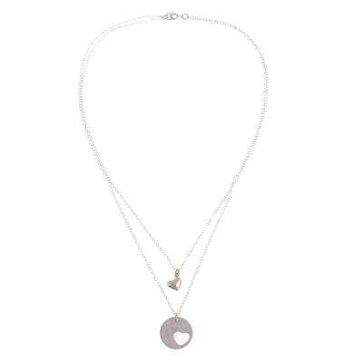 Sterling silver pendant necklace, 'Complementary Hearts' - Heart-Shaped Sterling Silver Pendant Necklace from Peru