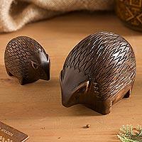 Wood figurines, 'Mother Hedgehog' (pair) - Cedar Wood Hedgehog Figurines from Peru (Pair)