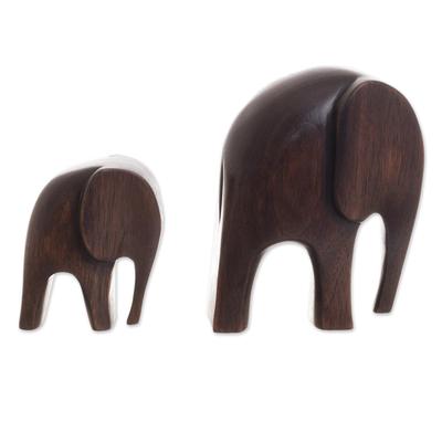 Wood figurines, 'Dark Brown Elephants' (pair) - Cedar Wood Elephant Figurines from Peru (Pair)