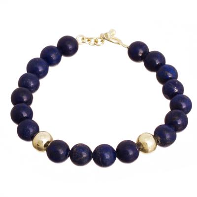 Gold accent lapis lazuli beaded bracelet, 'Golden Sea' - Gold Accent Lapis Lazuli Beaded Bracelet from Peru