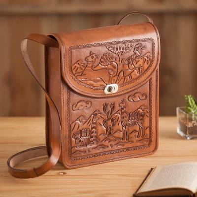 Leather sling shoulder bag, 'Andean Tale' - Hand-Tooled Embossed Andean Scene Brown Leather Shoulder Bag