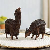 Wood sculptures, 'Couple in the Andes' (pair) - Hand-Carved Wood Alpaca Sculptures from Peru (Pair)