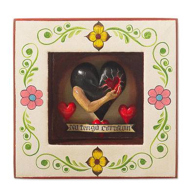 Ceramic and wood wall sculpture, 'Heart's Pain' - Black Heart-Themed Ceramic and Wood Wall Sculpture from Peru
