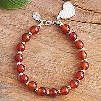 Carnelian beaded bracelet, 'Fiery Heart Passion' - Heart-Themed Carnelian Beaded Bracelet from Peru