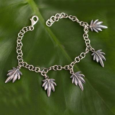 Sterling silver charm bracelet, 'Leaves of Nature' - Andean Leaf Nature Theme Sterling Silver Charm Bracelet