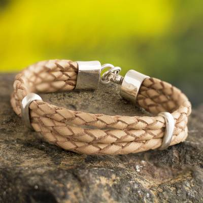 Sterling silver and leather cord bracelet, 'Brilliant Furrows' - Braided Natural Leather Bracelet with Sterling Silver Accent
