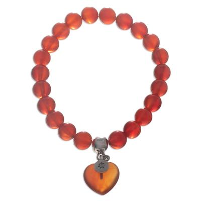 Carnelian beaded pendant bracelet, 'Soul Fire' - Carnelian Beaded Stretch Bracelet from Peru