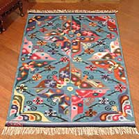 Wool rug, 'Garden of Butterflies' (4x5) - Wool Area Rug Blue Woven Handmade Peru (4x5)