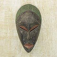 Ghanaian wood mask, 'Relax'