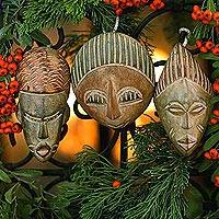 Wood ornaments, 'Three Kings' (set of 3) - Hand Carved African Mask Ornament Set